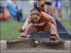 Sylvania Southview long jumper Elizabeth Sares lands in the pit. She finished second in the event.