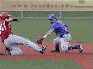 Central Catholic's Derich Weiland is safe at second after evading the tag of Eric Zmuda in a rundown .