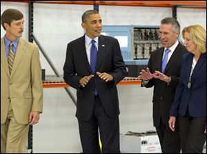 President Barack Obama tours Applied Materials Inc., with Rick Gesing, left, Mike Splinter, center, and Mary Humiston, right, during a visit to the facilities in