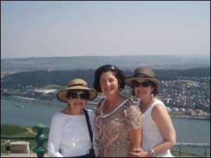 This 2012 photo provided by Anne D'Innocenzio shows her on the right with her sister Donna in the middle and mother Marie on the left in Rudesheim, Germany.