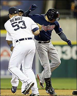 The Tigers' Joaquin Benoit (53) tags out the Indians' Asdrubal Cabrera at first base on Friday.