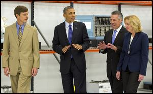 President Barack Obama tours Applied Materials Inc., with Rick Gesing, left, Mike Splinter, center, and Mary Humiston, right, during a visit to the facilities in Austin, Texas.