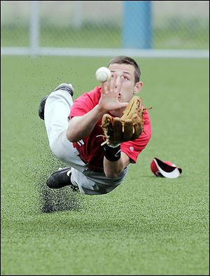 Central Catholic outfielder Colin Kaucher dives for a sinking liner.