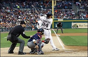 The Tigers' Miguel Cabrera (24) connects for a three-run home run off Indians starting pitcher Corey Kluber during the fourth inning.