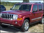 The 2006 Jeep Commander sits on display at Chelsea Proving Grounds in Chelsea, Mich. Chrysler is recalling 469,000 Jeep SUVs worldwide because they can shift into neutral without warning.