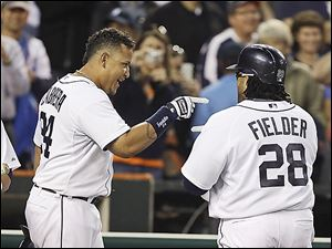 The Tigers' Miguel Cabrera, left, points to teammate Prince Fielder during a recent game. Both sluggers are on pace to rack up more than 160 RBIs each, which has not been accomplished since 1999.