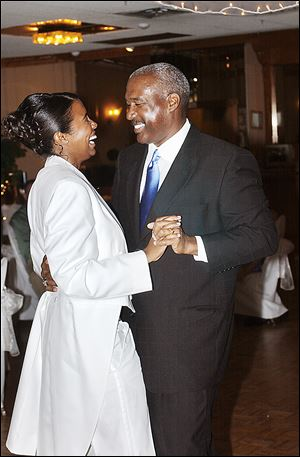 Ohio State University Athletic Director Gene Smith shares a dance with his daughter, Lindsay Smith, in 2007. Smith describes himself as an accepting person, whether it involves the sexual orientation of athletes at OSU or his daughter, who informed her parents while in college that she was a lesbian.