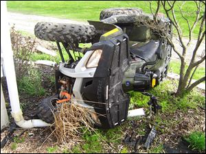 An all-terrain vehicle lies on its side following a crash in Wood County. There were 279 ATV-related deaths reported in the state of Ohio between 1982 and 2007. Eighty of those deaths involved children under the age of 16.