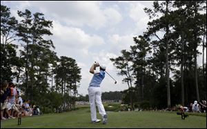 Sergio Garcia, of Spain, hits from the fourth tee during the third round of The Players championship golf tournament at TPC Sawgrass today in Ponte Vedra Beach, Fla.