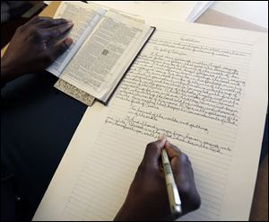 Phillip Patterson transcribes the King James Bible at this home on April 30 in Philmont, N.Y. Four years after starting with Genesis, Patterson, finished up the final lines of the Book of Revelation during a ceremony today at his church, St. Peter's Presbyterian in Spencertown, N.Y.