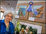 Elizabeth Jording of the Bedford Artists Club took first place in mixed-media art with 'Seascape 1' and 'Seascape 2.' The work is on display at the Bedford Branch Library in Temperance through May 21.