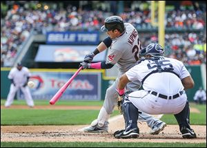 Cleveland's Jason Kipnis smacks a two-run double off Tigers starting pitcher Rick Porcello during the third inning. The double tied the game, but the Indians were later forced to rally in the ninth.
