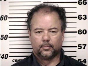 The Cuyahoga County Corrections Center booking photo of Ariel Castro, 52, after he was ordered to be held on $8 million bail in Cleveland.