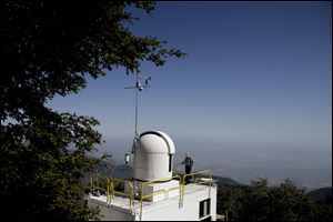 Senior research scientist Stanley Sander stands on the rooftop of the California Laboratory for Atmospheric. Remote Sensing (CLARS) facility at Mount Wilson, Calif. A mile above this city, sensors gaze down on the basin from atop Mount Wilson the way a satellite fixates on Earth, collecting pieces of information about Los Angeles' carbon footprint.