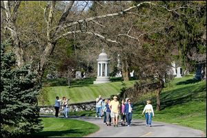 Locals enjoy beautiful weather as well as get in shape while learning history during a weekly walking program at  historic Woodlawn Cemetery and Arboretum on West Central Avenue in West Toledo.