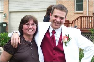 Matt Thompson with his mother before prom.