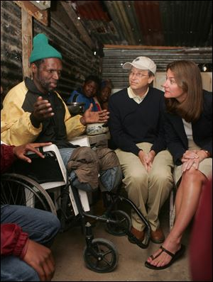 Tatomkhulu-Xhosa, left, explains to Bill and Melinda Gates, right, how he has lived with and been treated for tuberculosis in recent years at the Khayelitsha Site B Clinic in Cape Town, South Africa. Bill and Melinda Gates are in South Africa to learn more about efforts to fight TB and HIV/AIDS in the country. According to the latest rankings compiled by the Foundation Center, the Rockefeller Foundation is the 16th largest, with total assets of $3.5 billion, compared to $34.6 billion for the Bill & Melinda Gates Foundation.