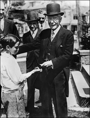 U.S. oil magnate and philantropist John D. Rockefeller gives a dime to a child. Underwritten by the vast wealth of the founder of Standard Oil, the Rockefeller Foundation was chartered in 1913 in Albany, N.Y. For several decades, it was the dominant foundation in the United States, breaking precedent with its global outlook and helping pioneer a diligent, scientific approach to charity that became a model for the field.