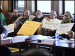 Protesters attend the University of Toledo Board of Trustees meeting today to protest the school's decision to end transfer agreements with local abortion clinics and cuts to students services.