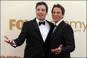 Seth Meyers, right,  is moving from his 'Weekend Update' desk to his own late night show on NBC. He will replace Jimmy Fallon, left, at the 12:35 a.m. 'Late Night' show as Fallon moves up an hour as Jay Leno's replacement on the 'Tonight' show.