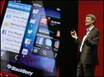 Thorsten Heins, president and CEO at BlackBerry holds up the new BlackBerry 10 mobile device at a conference in Orlando, Fla.