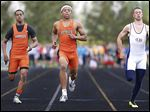 Southview junior Malcolm Johnson, center, wins the 100-meter dash ahead of teammate Jeremy Cook, left, and Liberty Benton's Chase Cook at the Clay Invitational. Johnson is aiming for a third straight sweep of the 100 and 200 at the NLL meet.