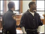 Devonte Harris, 19, is led away after being sentenced in Lucas County Common Pleas Court for his role in the robbery and shooting death of South Toledo gym owner Joseph Lengel, Jr.