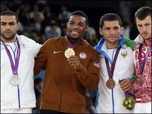 From left: Silver medalist Sadegh Saeed Goudarzi, from Iran; gold medalist Jordan Ernest Burroughs, from the United States; bronze medalist Soslan Tigiev, from Uzbekistan; and bronze medalist Denis Tsargush, from Russia, participate in the medals ceremony for men's 74-kg freestyle wrestling competition at the 2012 Summer Olympics, in London, last August.