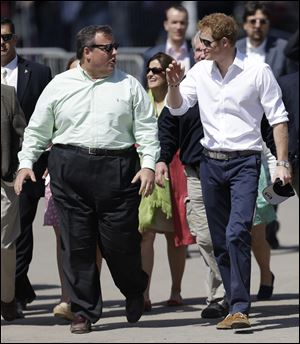 Britain's Prince Harry, right, walks with New Jersey Gov. Chris Christie at Casino Pier during a tour of the area hit by Superstorm Sandy, today, in Seaside Heights, N.J.