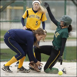 Clay's Honnah Susor steals third base as Notre Dame's Nikki Wilkins awaits the throw. Susor, a junior, leads the Eagles with a .603 batting average. Clay is 21-2 overall and 11-1 in the TRAC.