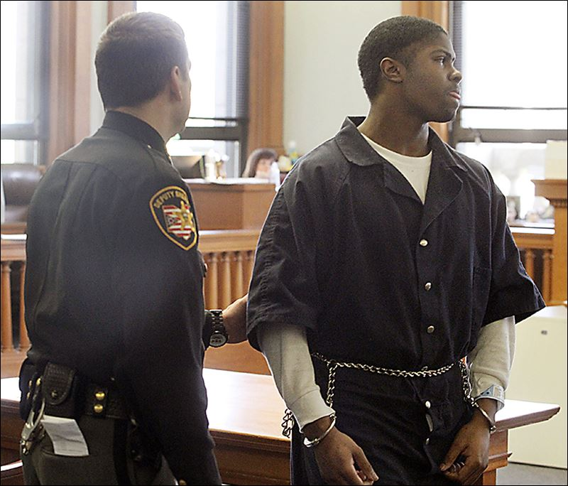 is led away after being sentenced in Lucas County Common Pleas Court ...