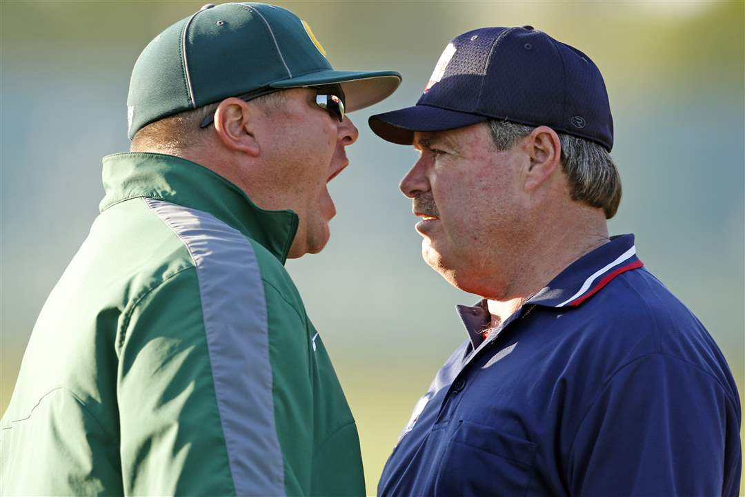 Oregon-Clay-head-coach-Gary-Isbell-shouts-at-an-umpire