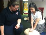 Amy Allen teaches Christine Scarlett CPR at Way Public Library.