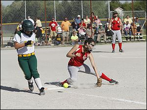 Clay's Haley Dominique reaches base safely as Central Catholic first baseman Lau