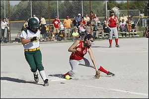 Clay's Haley Dominique reaches base safely as Central Catholic first baseman Lauren Best attempts to dig out the throw.