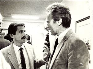 Thomas Walton, left, chats with Clint Eastwood during his run for mayor of Carmel, Calif.