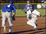 AW's Austin Kottenbrock gets caught in a pickle between Findlay pitcher Nolan Atwood(4) and SS Austin Powell (2) during the first inning  of a D-I sectional game on Thursday in Bowling Green.