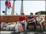 In this Wednesday, Aug. 22, 2012 photo, shoppers at a Target store in Chicago check the receipts of their purchases. According to the Labor Department, Friday, Sept. 14, 2012, more expensive gas drove up U.S. consumer prices in August by the most in three years. But outside energy, inflation was tame. The Labor Department says consumer prices rose a seasonally adjusted 0.6 percent last month, the first increase since March. Higher gas prices accounted for 80 percent of the increase. Food prices rose 0.2 percent. (AP Photo/Sitthixay Ditthavong)