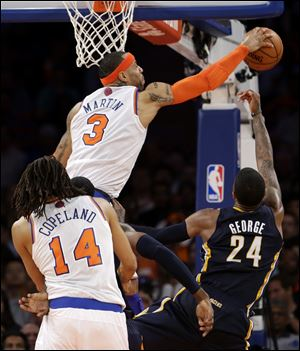 New York Knicks' Kenyon Martin (3) blocks a shot by Indiana Pacers' Paul George (24) in the second half.