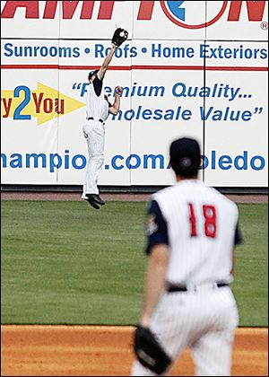 The Mud Hens Danny Dorn leaves his feet to make a catch on Thursday night at Fifth Third Field.