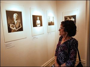 Vicki Marsh, of Maumee, takes a look at several pieces by photographer Matika Wilbur.