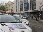 Police cars park outside a hotel during the 66th international film festival, in Cannes, southern France today. A French police official says a thief or thieves stole about $1 million worth in jewelry inside a safe in a Novotel hotel room, against the backdrop of the Riviera resort town's film festival.