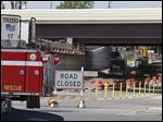 Construction crews with a bulldozer struck a 16-inch medium-pressure gas line on Upton Avenue at Central Avenue under I-475, clogging traffic for hours and forcing the evacuation of five homes.