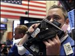 FILE - In this Thursday, May 2, 2013, file photo, Trader Kevin Lodewick works on the floor of the New York Stock Exchange. World stock markets were mixed Friday May 17, 2013 as investors digested a slew of disappointing data from the U.S. ahead of the release of a key measurement of the country's economic outlook.  (AP Photo/Richard Drew)