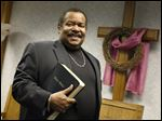 Bishop Nelson Clark poses at the Power House Tabernacle Pentacostal Christian Church in Toledo. He is celebrating 50 years as a minister.