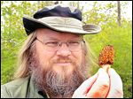 Antoine Delaforterie holds a morel mushroom that he found in Rochester Hills, Mich.
