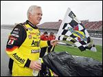 Frank Kimmel celebrates on pit road after winning the rain-shortened ARCA Series race May 3 at the Talladega Superspeedway.