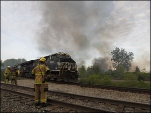A train temporarily prevented firefighters from reaching  a marsh fire in Monroe, Mich.