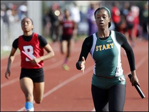 Daesha Ware of Start High School runs the final leg of the 4X100 meter relay to win the event.