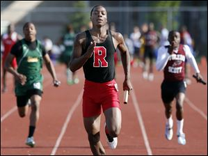Tribune Dailey of Rogers High School runs the final leg of the 4X100 meter relay to win the event.